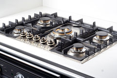 Modern large gas stove. In luxurious kitchen Stock Photography