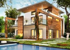 Modern large house with lighting and pool. Modern large house with lighting and swimming pool royalty free stock image