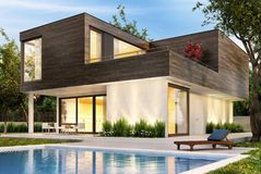 Modern house with pool and evening lighting stock photo