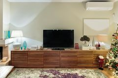 Contemporary wooden living room cabinet with flat tv. stock photos