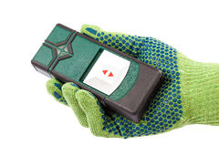 Modern laser measuring level in hand with glove. Stock Image