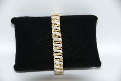 Ladies Gold bracelet and white diamonds Royalty Free Stock Images