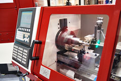 Modern lathe with CNC. And workpiece stock photo