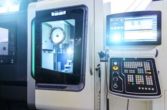 Modern lathe with CNC and workpiece and transparent windows for process control. Modern lathe with CNC and workpiece and transparent windows for control royalty free stock photo