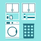 Modern laundry with washing machine and washing powder. Royalty Free Stock Photos