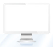 Modern LCD computer monitor on glass table. Isolated on white background Royalty Free Stock Photography