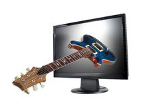Modern lcd monitor and guitar. Isolated Stock Photos