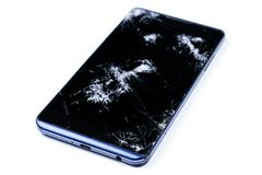 Modern LCD touch screen display mobile smartphone is cracked and broken after drop. Broken phone glass close up view, isolated. On white background for design stock images