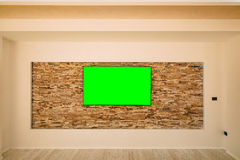 A modern LCD TV with a green screen hanging Royalty Free Stock Photography