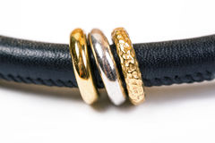 Modern  leather neklace with gold and silver rings Stock Images