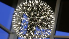 Modern LED Metal Ball Chandelier. Modern LED metal big ball chandelier with a lot of light bulbs, interior design stock footage