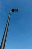 Modern LED street lamp post against a blue sky Stock Photos