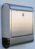 Modern letterbox metal. Modern post box made of metal with paper roll royalty free stock image