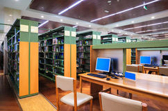 Modern library interior. Library setting with books and computers royalty free stock photography