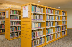 Modern library. Reference section of a modern library Royalty Free Stock Photos