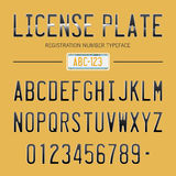 Modern License Plate font for registration numbers, with sample design  on background Royalty Free Stock Images
