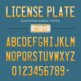 Modern License Plate font for registration numbers, with sample design  on background Royalty Free Stock Photos