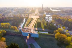 Modern life in Brest city at sunrise. Memorable place surrounded by green park. Brest, Belarus - April 19, 2019: Modern life in Brest city at sunrise. Memorable royalty free stock image