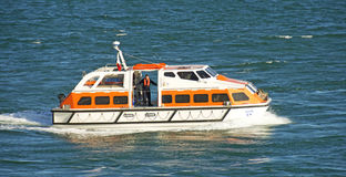 Modern Lifeboat. A lifeboat from a modern Cruise Liner in action. This lifeboat is being used as a tender to ferry people from the boat to shore but will also be Stock Image