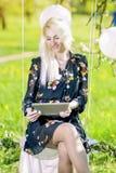 Modern Lifestyle Concept: Caucasian Blond Female Reading Ebook o Royalty Free Stock Photos