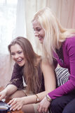 Modern Lifestyle Concept and Ideas. Two Happy Positive and Laughing Caucaisan Girlfriends Having Fun. Stock Images