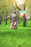 Modern Lifestyle Concept. Young Caucasian Blond Female with Bunch of Air Balloons Stock Photo