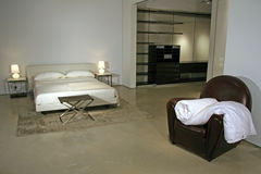 Modern Lifestyle - Interior of a Bedroom. In a high end classy apartment Stock Image