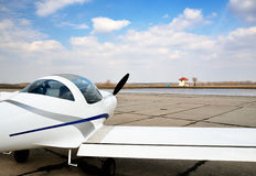 A modern light aircraft on the airfield Stock Photo