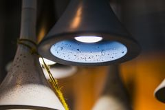 Modern light bulbs in a cafe. Ceiling light fixtures. Chandelier from cement.  Stock Photography