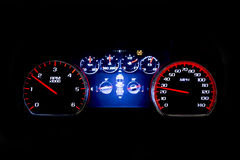 Modern light car mileage on black background. Modern light car mileage dashboard, milage  on a black background. New display of a modern car Royalty Free Stock Photo