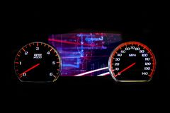 Modern light car mileage on black background Futuristic. Modern light car mileage dashboard, milage  on a black background. New display of a modern car Royalty Free Stock Photography