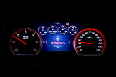 Modern light car mileage on black background Gain. Modern light car mileage dashboard, milage isolated on a black background. New display of a modern car. Gain Stock Photos