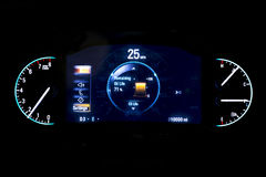 Modern light car mileage on black background 25 mph. Modern light car mileage dashboard, milage isolated on a black background. New display of a modern car. RPM Royalty Free Stock Image