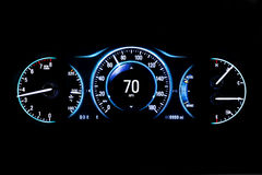 Modern light car mileage on black background 70 mph. Modern light car mileage dashboard, milage isolated on a black background. New display of a modern car. RPM Stock Image