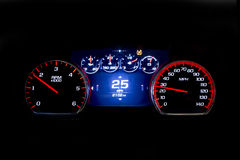 Modern light car mileage on black background 25 mph. Modern light car mileage dashboard, milage  on a black background. New display of a modern car. 25 mph Stock Photography