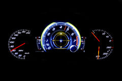 Modern light car mileage on black background MPH. Modern light car mileage dashboard, milage  on a black background. New display of a modern car. MPH, fuel and Royalty Free Stock Images