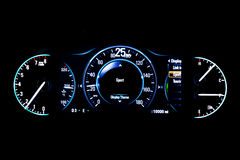 Modern light car mileage on black background Sport 25 mph. Modern light car mileage dashboard, milage isolated on a black background. New display of a modern car Royalty Free Stock Photos