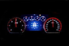 Modern light car mileage on black background TSI. Modern light car mileage dashboard, milage  on a black background. New display of a modern car. Tire pressure Royalty Free Stock Image