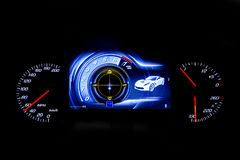 Modern light car mileage on black background MPH. Modern light car mileage dashboard, milage isolated on a black background. New display of a modern car. MPH Royalty Free Stock Photography