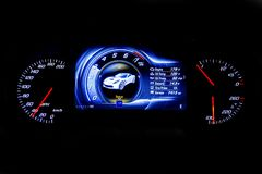 Modern light car mileage on black background MPH. Modern light car mileage dashboard, milage isolated on a black background. New display of a modern car. MPH Stock Image