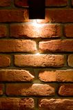 LED wall lighting, red brick and light background stock photography