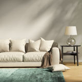 Modern light grey sofa in a contemprary living room. Rendering of a Modern light grey sofa in a contemprary living room Stock Photography