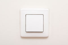 Modern light switch on white wall Stock Photos