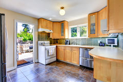Modern light tone kitchen room with exit to backyard Stock Photos