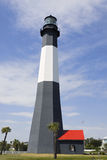 Modern lighthouse. Tall modern lighthouse with surrounding palm trees Stock Photo