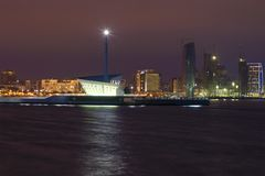 A modern lighthouse in the Baku bay. Night Baku, Azerbaijan. A modern lighthouse in the Baku bay. Night Baku. Azerbaijan Stock Photo