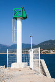 Modern lighthouse tower, Propriano, Corsica. Modern white lighthouse tower with green top in Port of Propriano, South region of Corsica island, France Royalty Free Stock Photography