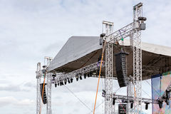 Modern lightning and sound equipment mounted on outdoor stage on stock photo