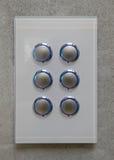 Modern lightswitch. Six blue backlit buttons modern lightswitch Royalty Free Stock Photos