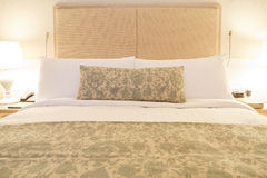 Modern linen bedding wood headboard. Luxuary wood headboard with modern and cozy linen bedding stock images